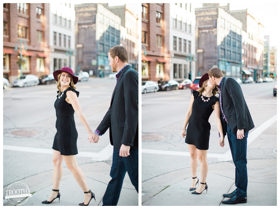 couple walking and kissing on the streets of Milwaukee's Historic Third Ward