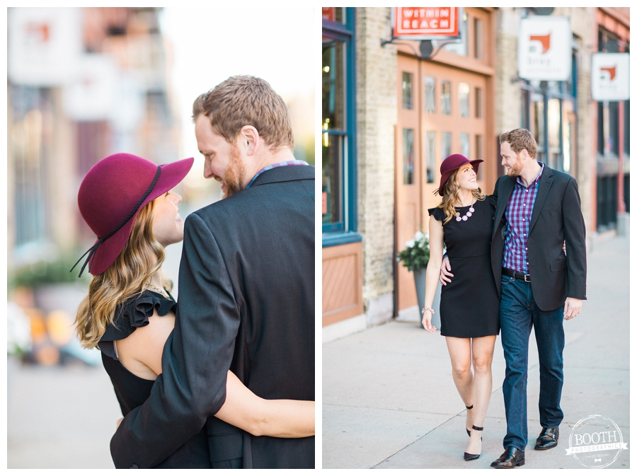 couple hugging and kissing along the streets of Milwaukee's Historic Third Ward
