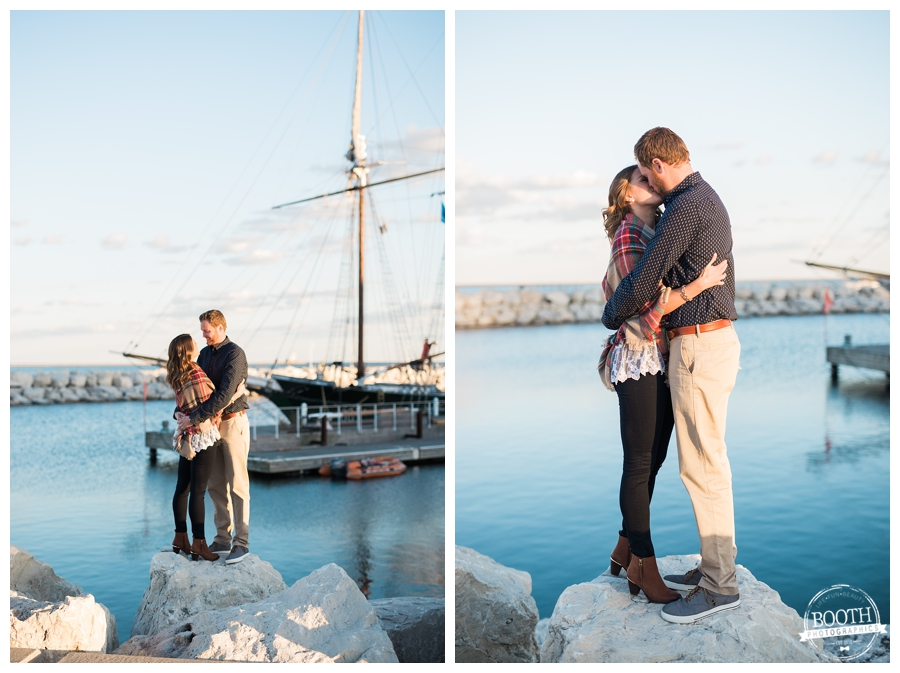 couple hugging along a shipping harbor on Lake Michigan in Milwaukee, WIsconsin