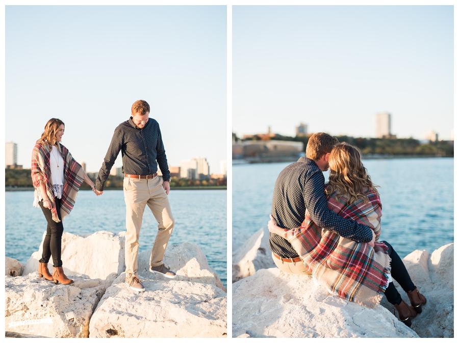 couple walking along Lake Michigan in Milwaukee, WIsconsin