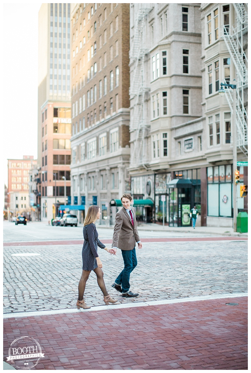 couple walking across brick streets in downtown Milwaukee Wisconsin