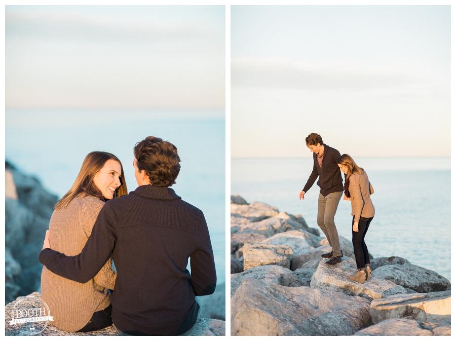 engaged couple walking along the rocks on Lake Michigan n Milwaukee Wisconsin