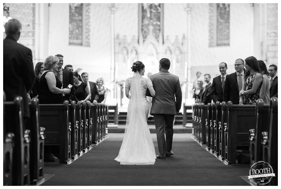 bride walking down the aisle to her groom in their St. James Episcopal Cathedral wedding in downtown Chicago
