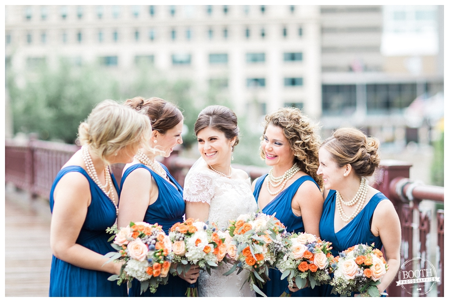 bride smiling with her bridesmaids on Lurie Bridge in downtown Chicago