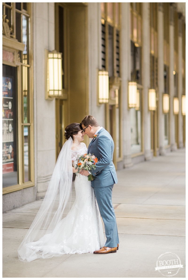 bride and groom smiling and kissing at the Lyric Opera in Chicago, IL