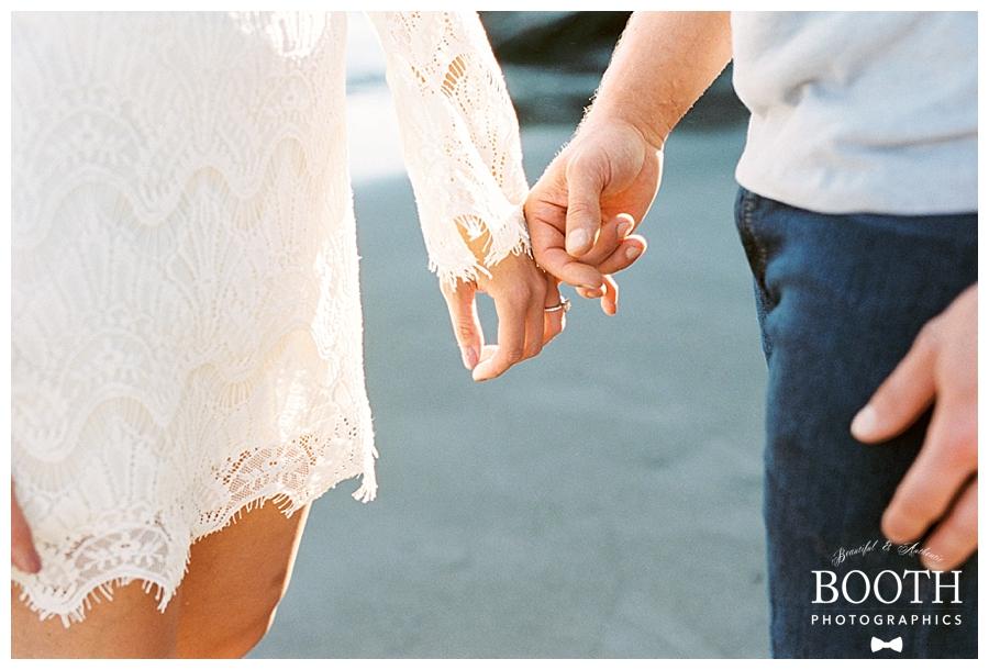 couple holding hands at Muir Beach, California