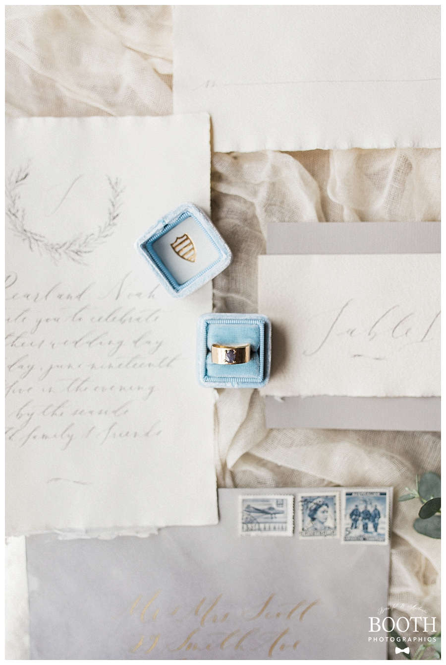 handmade wedding ring in The Mrs. Box on torn paper calligraphy invitation suite by Plume Calligraphy