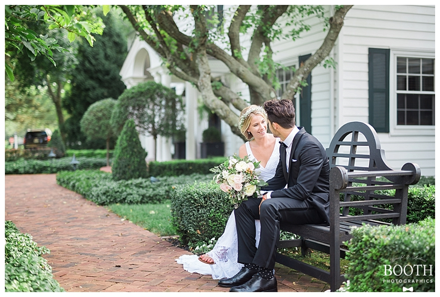 couple talking at their bohemian romantic outdoor private estate wedding