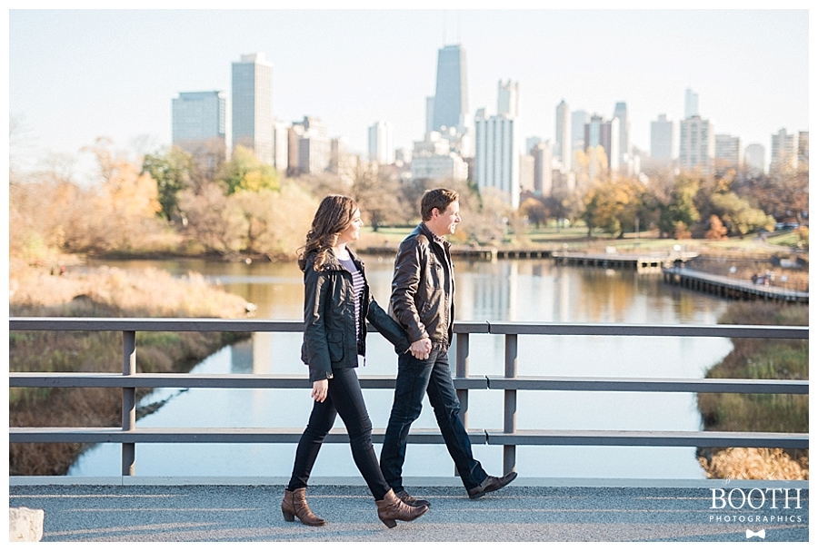 couple holding hands and walking through Lincoln South Park, Chicago, IL