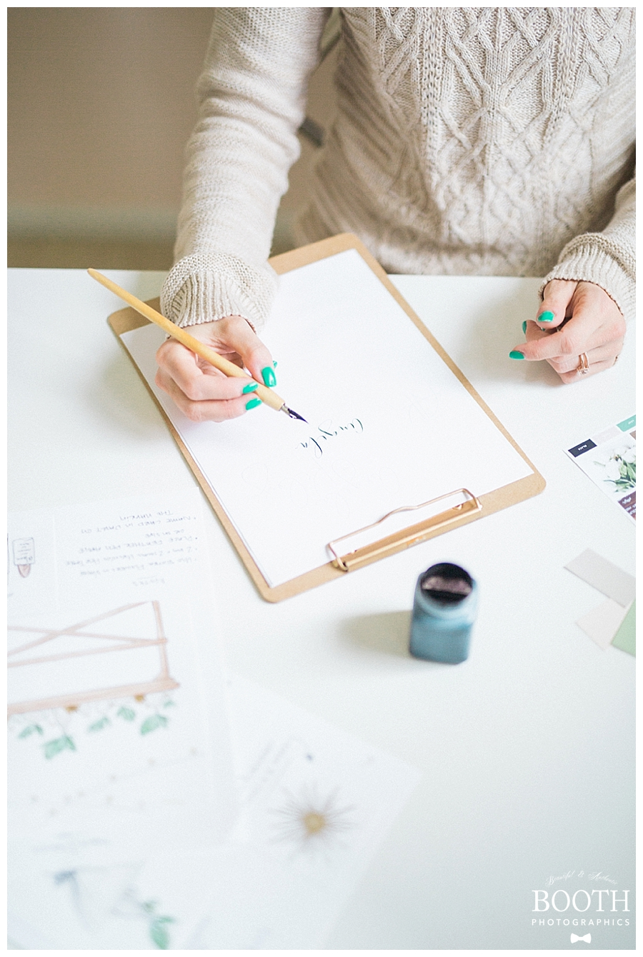 calligrapher creating a wedding logo in her mid century modern home office