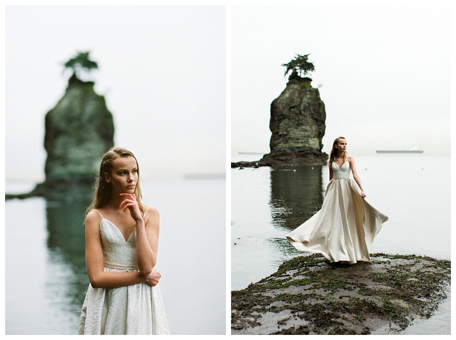 Bride dancing in front of Siwash Rock in Stanley Park,Vancouver in a Truvelle wedding dress, photographed by destination wedding photographers, Booth Photographics