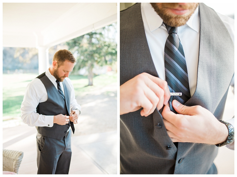 groom putting on his custom gray wool suit for his rustic fall outdoor wedding