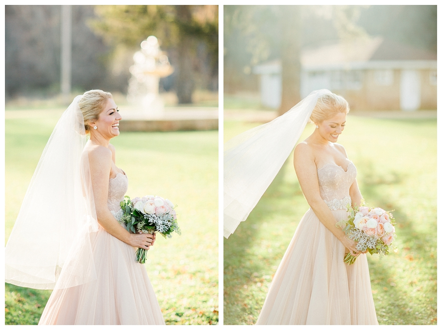 Bride carrying her blush and ivory rose and dusty miller bouquet at her rustic fall outdoor wedding