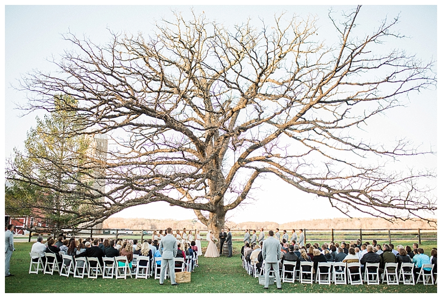 a rustic outdoor fall wedding ceremony at Sugarland Barn