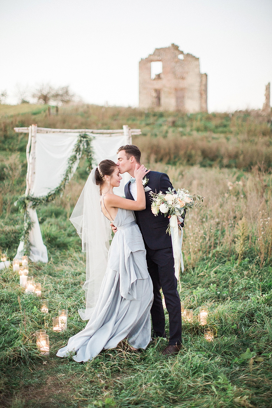 fine art photography of outdoor european inspired ruins wedding ceremony