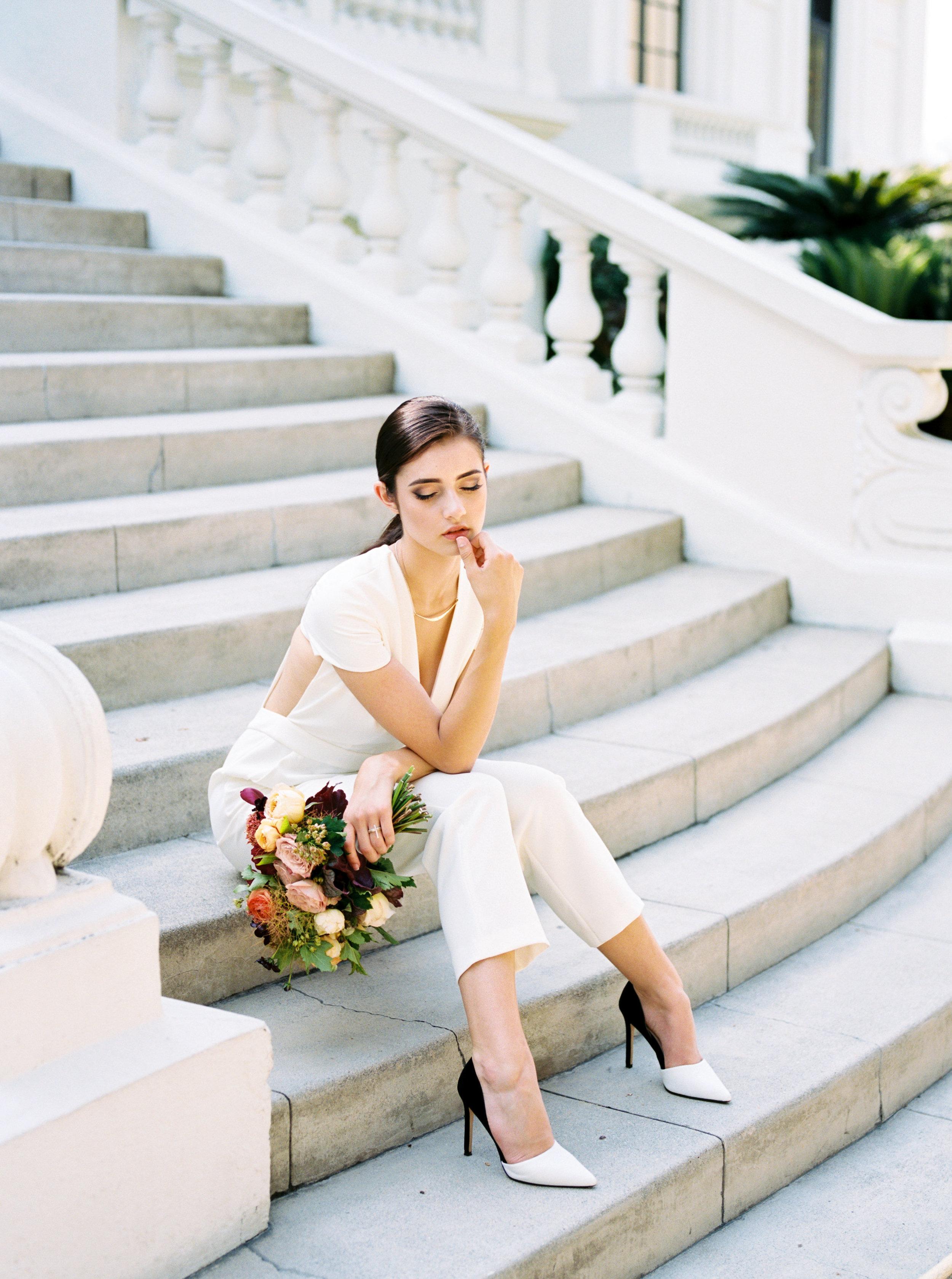 Bride wearing Delphine Manivet pantsuit for her private estate wedding in Pasadena, California