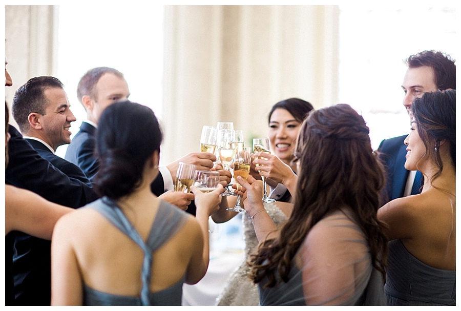 bridal party toasting before their wedding at the Madison Club