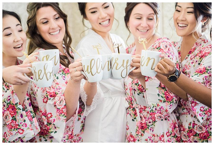 Bride and her bridesmaidstoasting with custom coffee mugs
