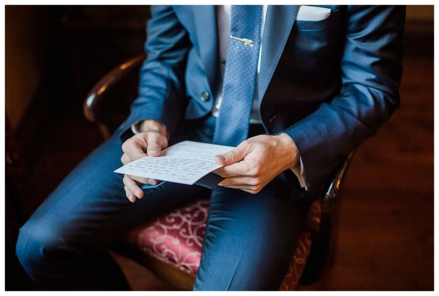 groom reading a card from his bride for his Madison Club wedding