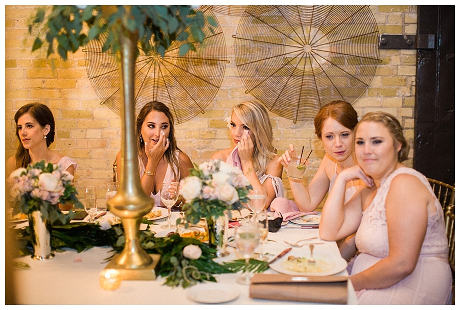 wedding toasts at a feminine and industrial wedding reception at the Pritzlaff