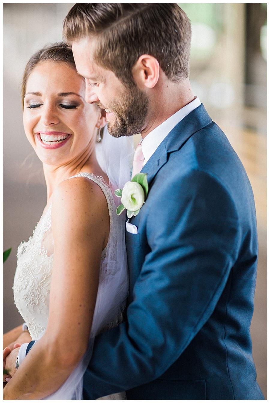 bride and groom photos on industrial bridge in Milwaukee