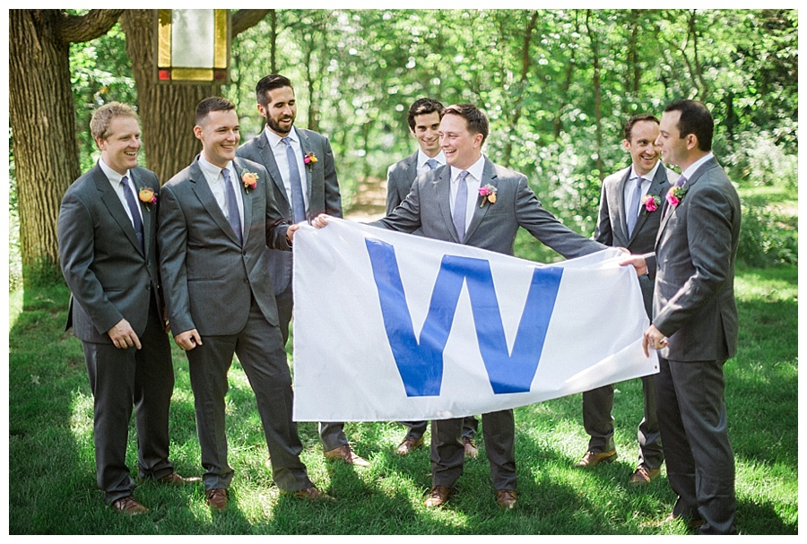 groomsmen holding Cub's W flag at wedding at the Farm at Dover
