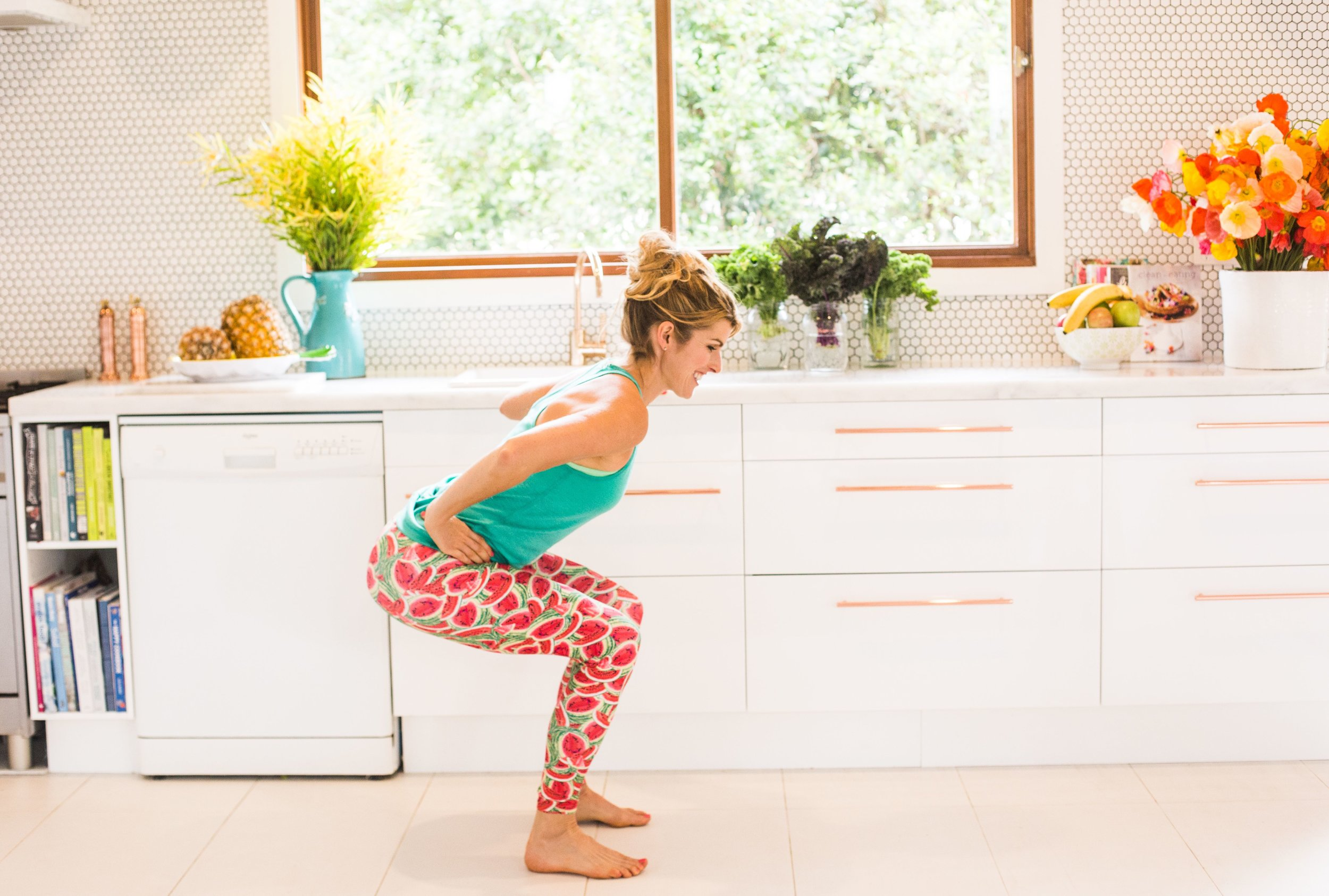 Squats at the kitchen counter.
