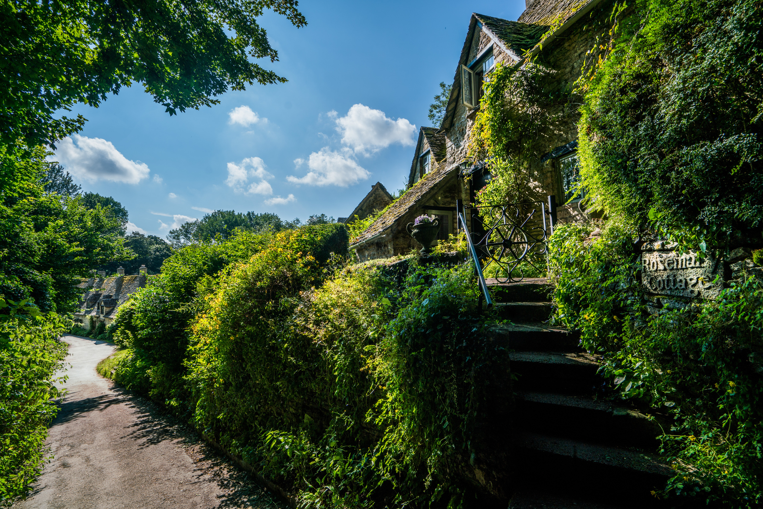 Rosemary Cottage (see the sign?), Arlington Row, Bibury, Cotswolds AONB, England, UK. Sony A7rII, Sony 16-35mm f/4 at 16mm, ISO 100, f/8, 1/320th. Edited in Lightroom and Photoshop.