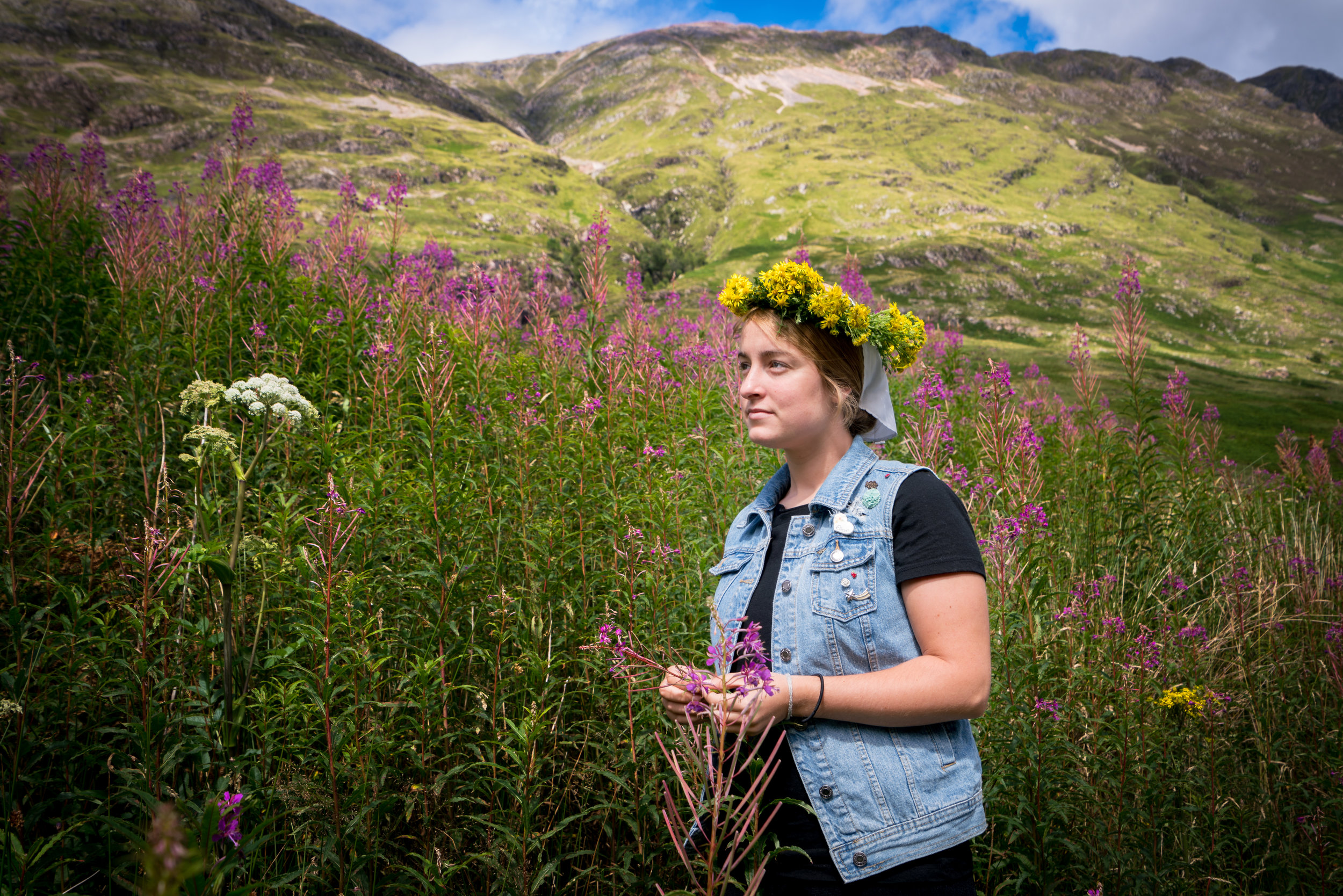 My sister Heidi posing amidst the flowers and Scottish mountains with the flower crown she made