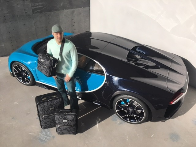 Paris Renfro (6-inches tall in this photo) is posing next to his die-cast Bugatti Chiron.  To see more of Paris Renfro designs, see his website at  www.prdminiatures.com