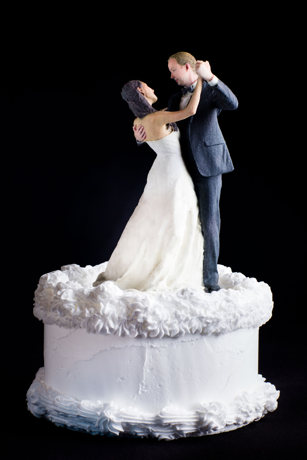 No day is as special as your wedding day! That is why this couple decided to create their own cake topper that is as perfectly unique as it is perfectly them.