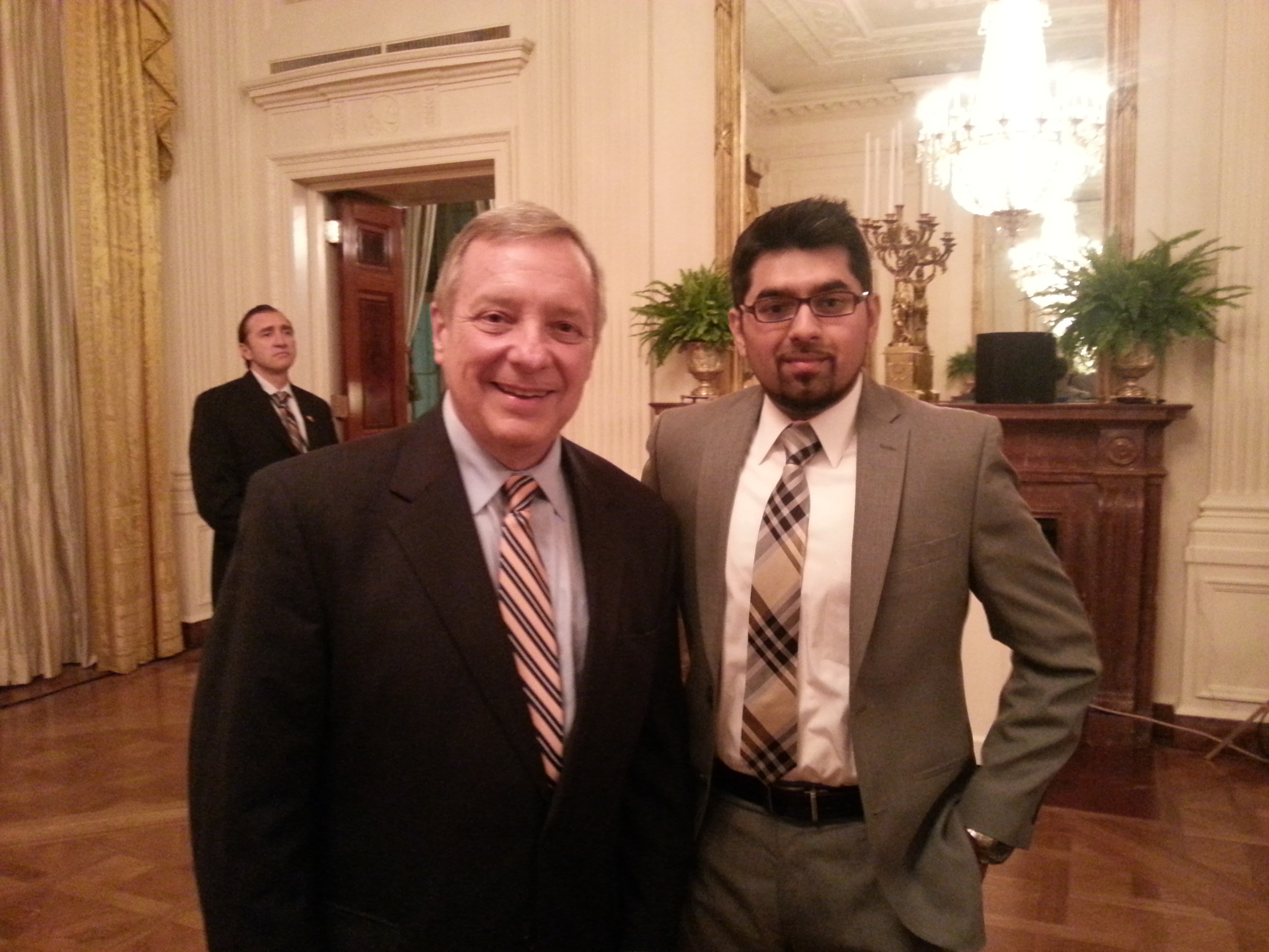 Dr. Chaudhry with Senator Dick Durbin discussing access to dental care