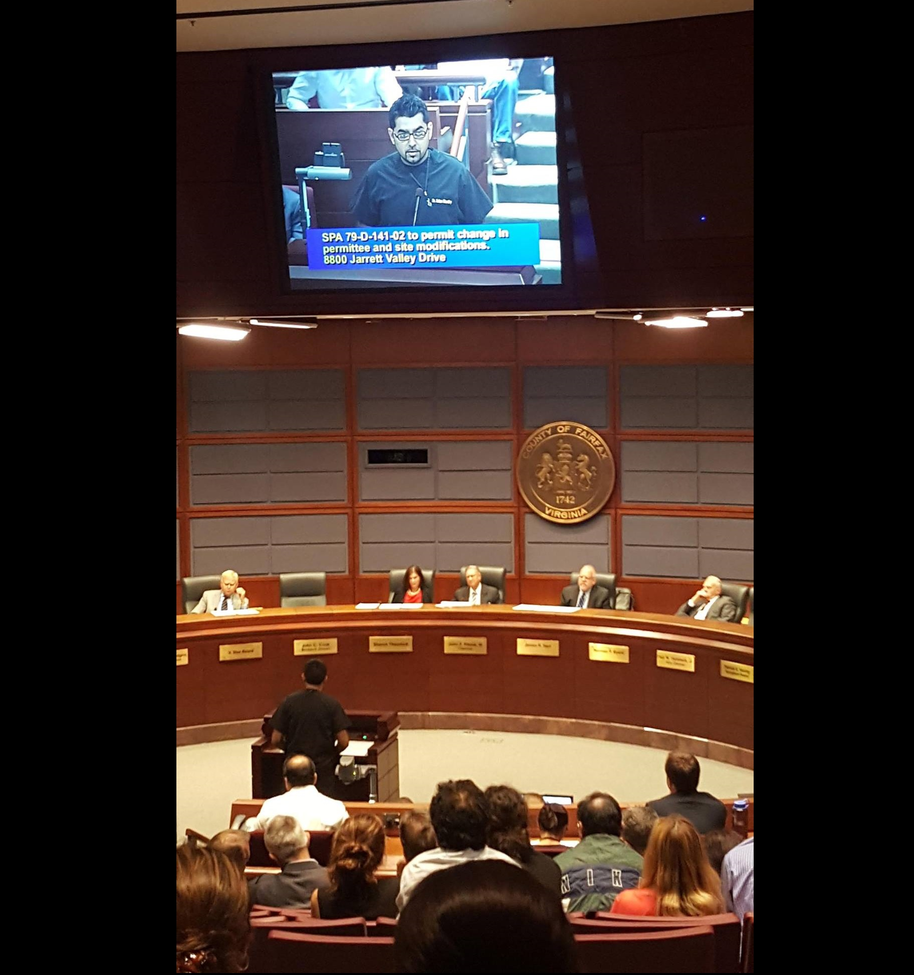 Dr. Chaudhry presenting before Fairfax County officials