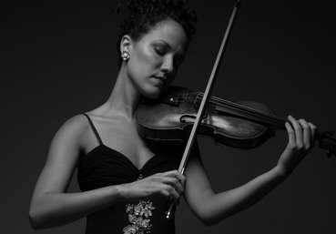 "MAIANI DA SILVAViolin - Los Angeles-based violinist Maiani da Silva enjoys a varied career as a freelancer, feeling equally at home playing in concert halls, recording studios, breweries, and parked cars. She enjoys exploring contemporary works as much as classical masterpieces, and can occasionally be found interpretive dancing during measures of rest, or in a Latin band playing some percussive instrument. Always in pursuit of new collaborations, including working with composers and other artists, Maiani is the Co-Founder of Merge Collaborative, a new salon-style interdisciplinary series in Los Angeles; Summa piano trio, with forthcoming recordings under the Naxos umbrella (Parma); and a newly formed duo, The Furies, promoting works by feminist composers. She is also the curator of a new series, New Music Hollywood, at Urban First Aid, promoting new music from various genres. Maiani is dedicated to working with cutting edge contemporary ensembles, most notably wildUp , with whom she's performed during Los Angeles Philharmonic's Noon to Midnight—a 12-hour marathon celebrating L.A.'s top new-music ensembles—both in 2016 and 2017. Other groups include Aperture Duo, the Boston Conservatory's ensemble-in-residence Ludovico Ensemble, One Found Sound, White Rabbit Ensemble, New Music Brandeis, Juventas New Music Ensemble. As a Bang On a Can fellow, Maiani worked directly with George Lewis and Louis Andriessen, as well as BOAC All-Stars at Mass Moca for another marathon. There, she performed an abridged version of Andy Akiho's Ping Pong Concerto with David Cossin, and also dabbled in composition while performing on a 9-foot banjo. Having played across the country from Juneau to New York, and internationally from Western Europe to Eastern Asia, Maiani has orchestral performance experience working with ensembles like the Los Angeles Ballet Orchestra, Pacific Opera Project, Pasadena Opera, L'Orchestre Lamoureux (Paris), St. Matthew's Chamber Orchestra, and has toured with the Philharmonie Leipzig in China, among others. Aside from her classical and experimental work, she is active in the session scene, and as a live-pop performer. With performance artist Taylor Mac she premiered the 24-Decade History of Popular Music in Brooklyn in 2016 (you guessed it, another marathon!) and rejoined the band for a portion of the tour. Maiani has also collaborated with Nan Schwartz, Peter Gabriel, Kanye West, Anoushka Shankar, Childish Gambino, Parisian electro-rock band Satine, Trans Chorus of L.A., New York cabaret singer Joey Arias, and Rod Stewart, with whom she danced on stage to ""If you think I'm sexy"" while playing in a tragically flat-ridden key. She has also recorded soundtracks for movies and TV shows such as the indie-feature film Stella, various shows on The Disney Channel, Netflix's Dear White People, and the TV show For The People which airs on ABC/Disney. Maiani holds a B.M. and a Graduate Performance Diploma from The Boston Conservatory, where she studied under Magdalena Richter and Irina Muresanu as a scholarship recipient, an Artist Diploma with Honors from the San Francisco Academy Orchestra, and she also studied under the tutelage of Mela Tenenbaum in Brooklyn. She is looking forward to spending a couple of weeks this summer as a 2018 fellow of the Eighth Blackbird Creative Lab.Visit MaianiDaSilva.com and MergeCollaborative.com to learn more."