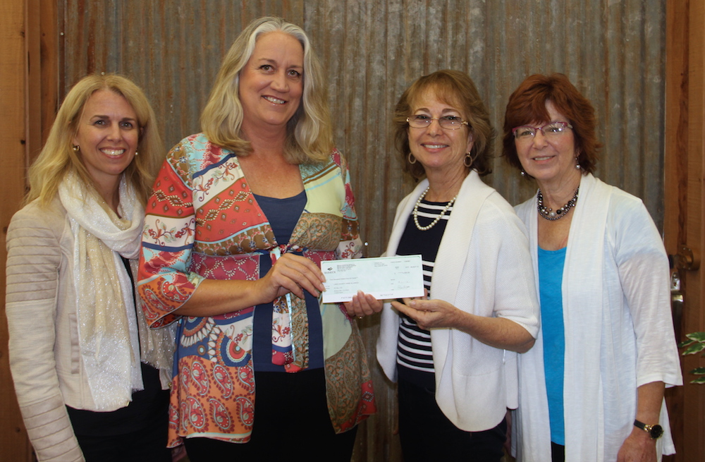 Homestake Mining Company (Barrick Gold Corporation) donated $5,000 to #LakeCountyRising. In this photo: Debra Sommerfield, Lake County Winegrape Commission; Peggie King, Homestake Mining Company; Sharron Zoller, Lake County Wine Alliance; and Terry Dereniuk, Lake County Winery Association.