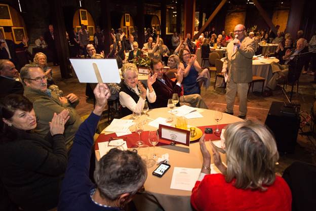 Auctioneer Fritz Hatton leads bidding on the event's 10 live auction lots.  Photo: Nathan DeHart