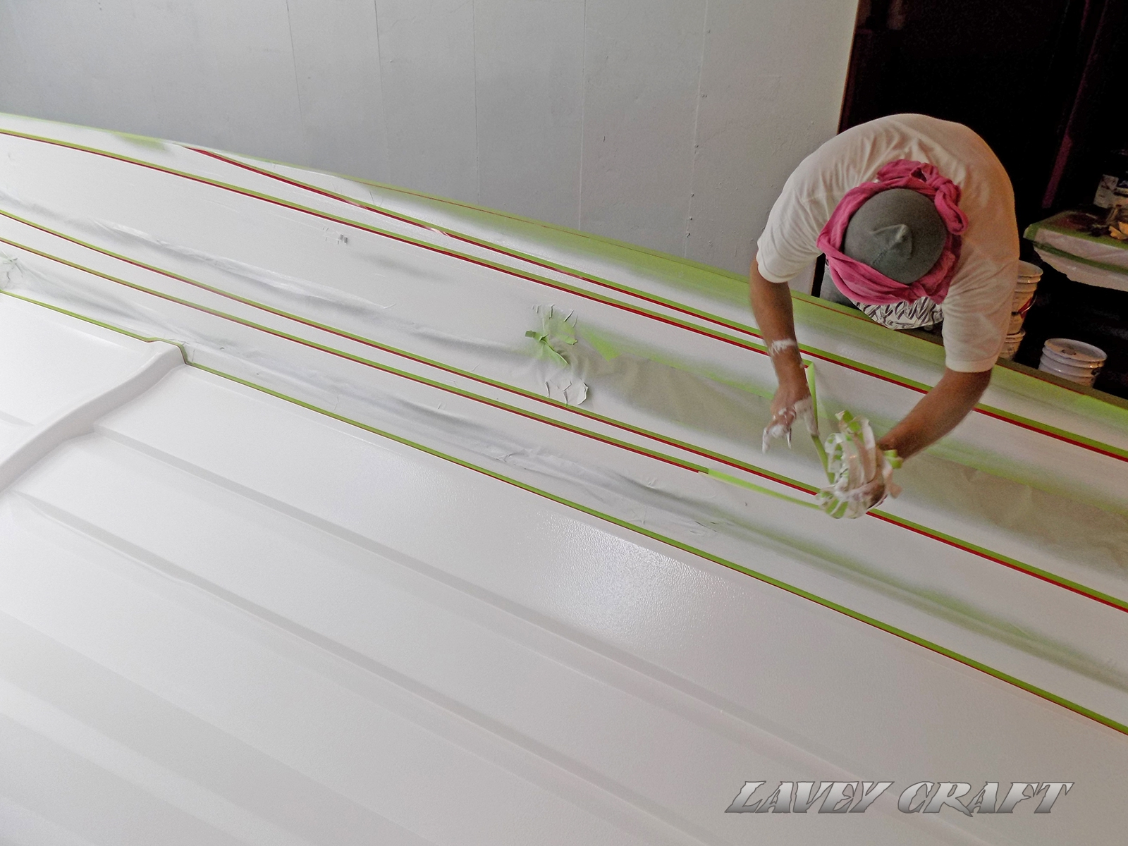 Removing tape around the white, getting ready for the next color