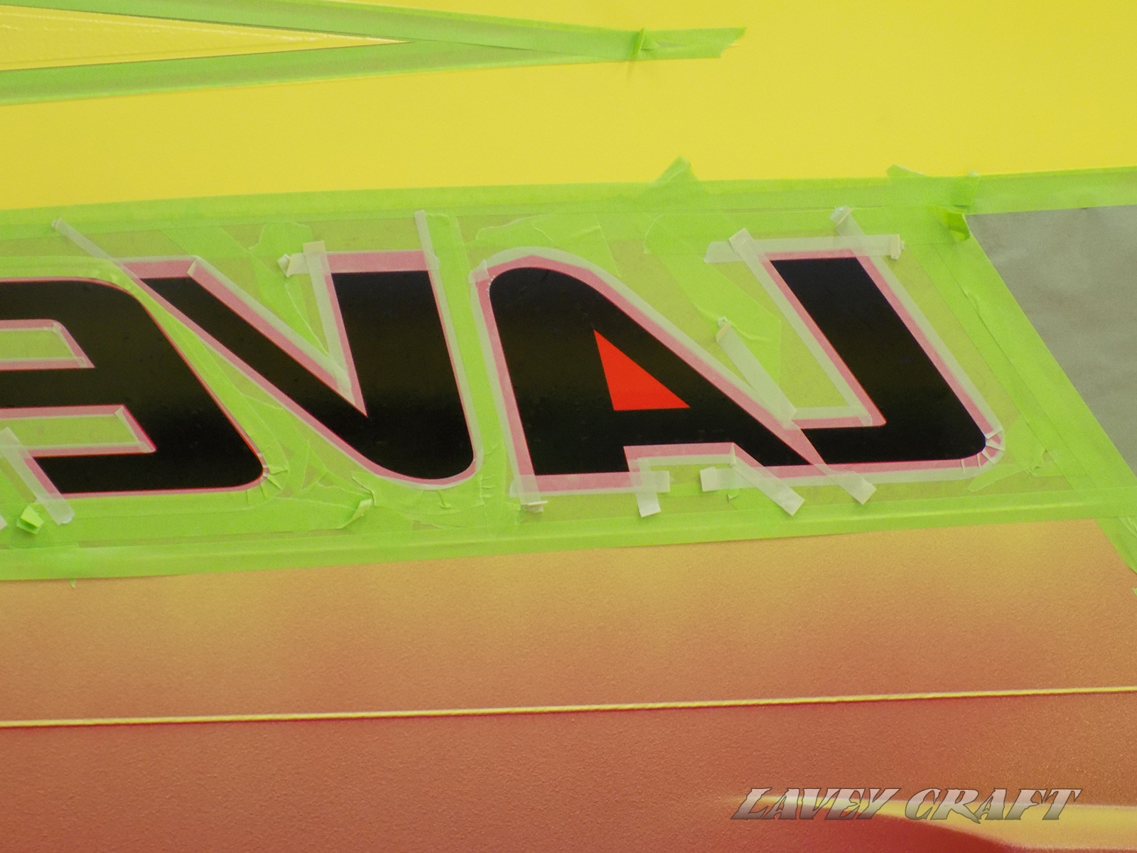 Complex taping around the letters before they can be removed and gelcoat applied