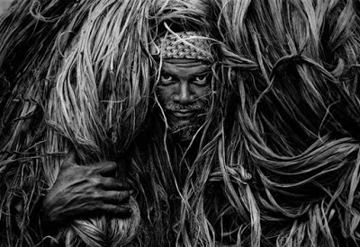 collected: posing to the camera with raw jute on shoulder