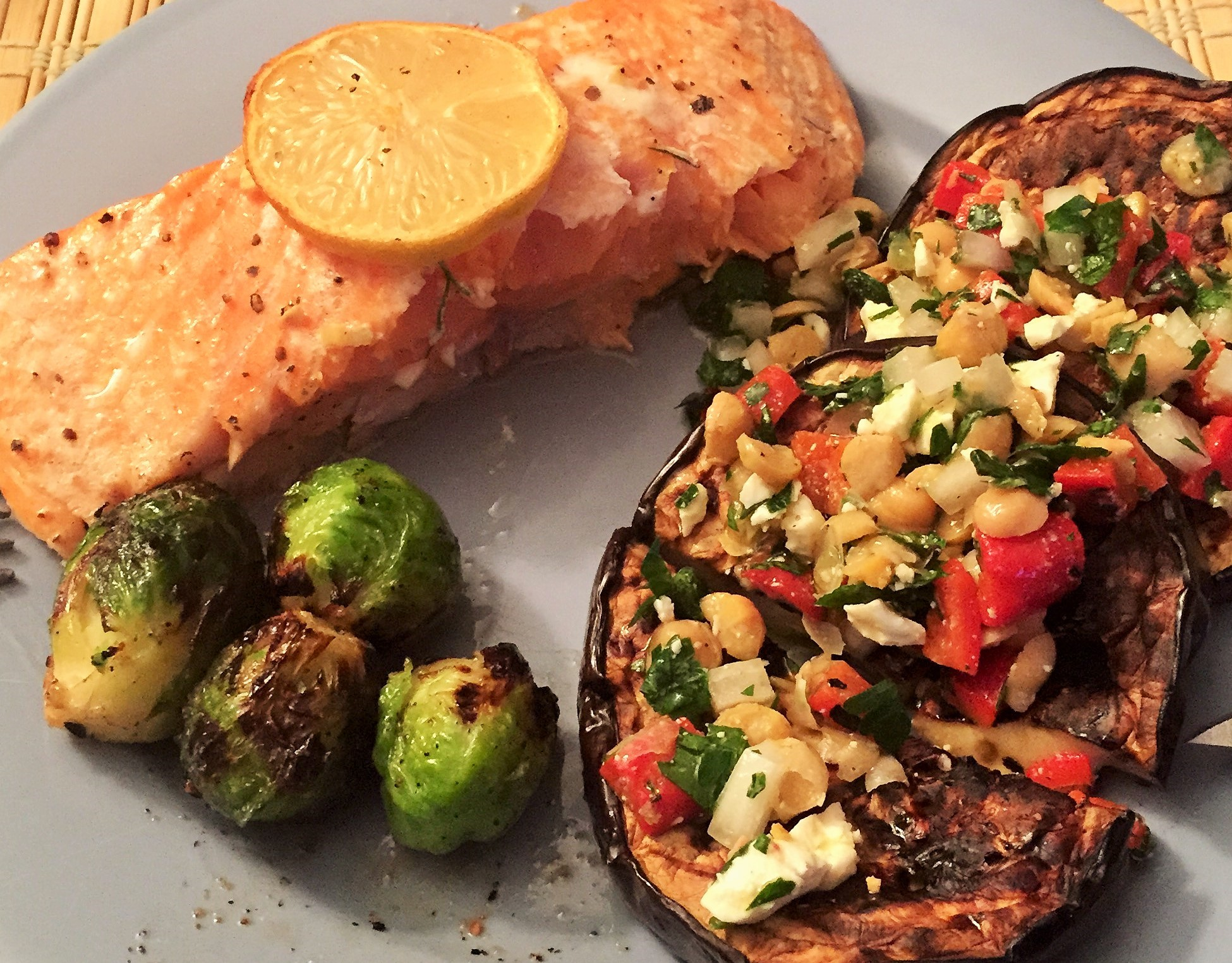 Note: This is NOT the first meal he cooked for me, but a different salmon-focused meal he made, along with roasted brussel sprouts and eggplant topped with a chickpea, tomato and feta salad.