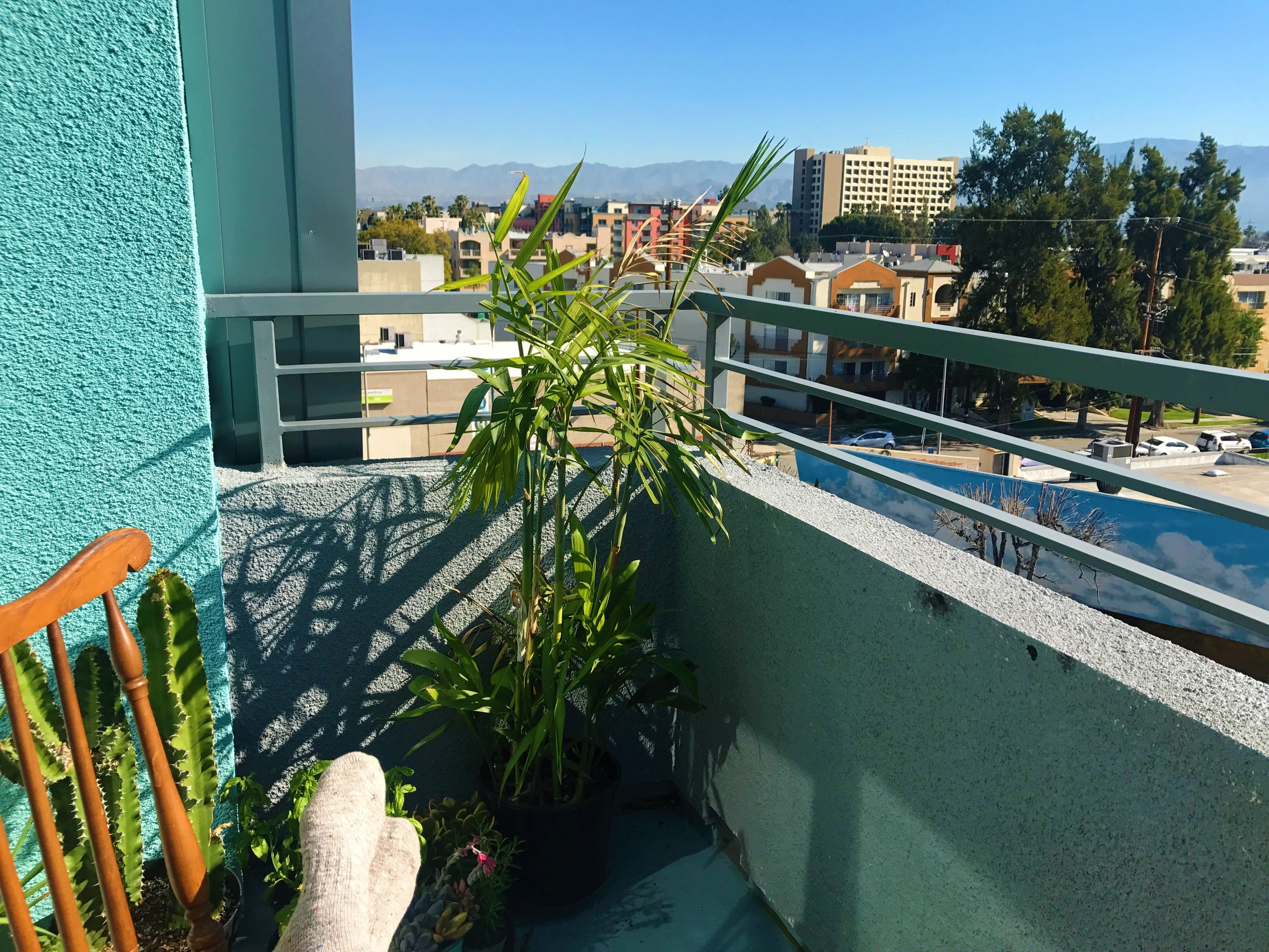 "This shot was as I was studying lines on our balcony for my first audition in L.A.  I looked around and realized how incredible it was.  There are a lot of less glamorous, ugly moments in between lovely ones like this.  But I realized, on this day, I really was ""living the dream."""