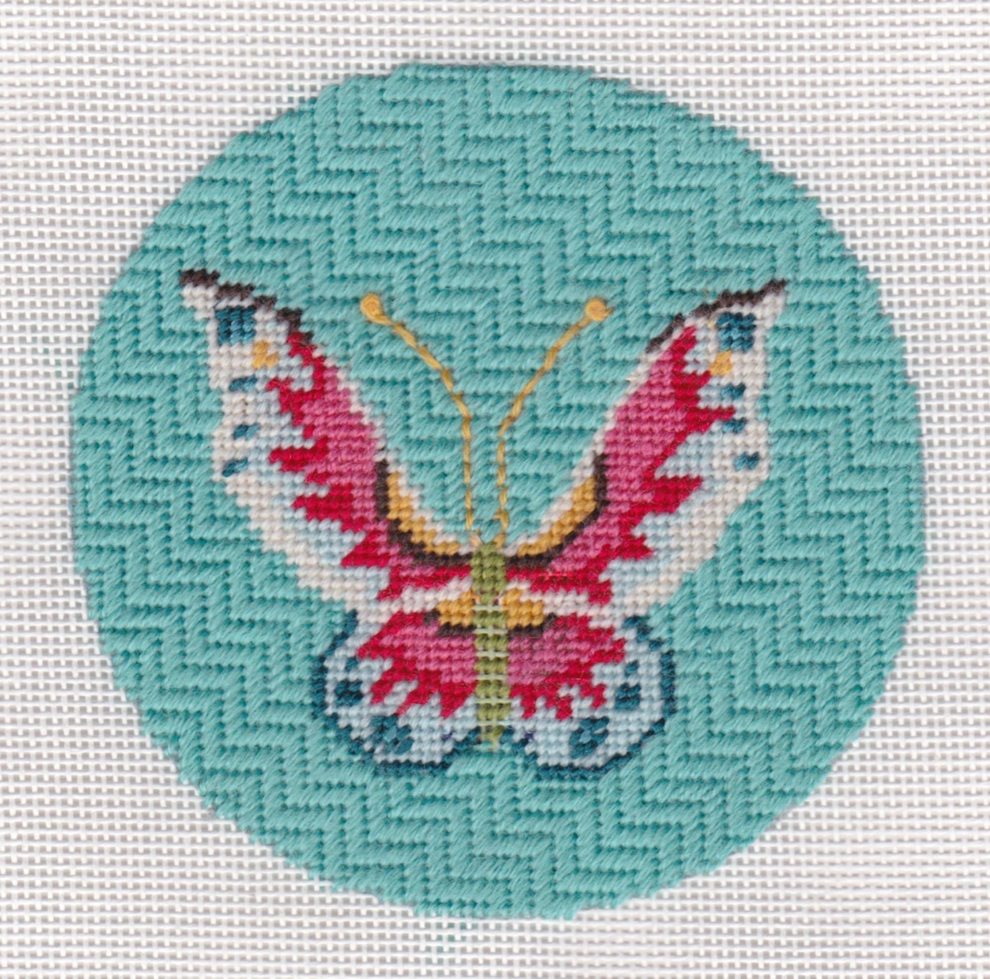 The design area measures 4 inches round and is stitch-painted on 18 ct. mesh mono Zweigart needlepoint canvas.