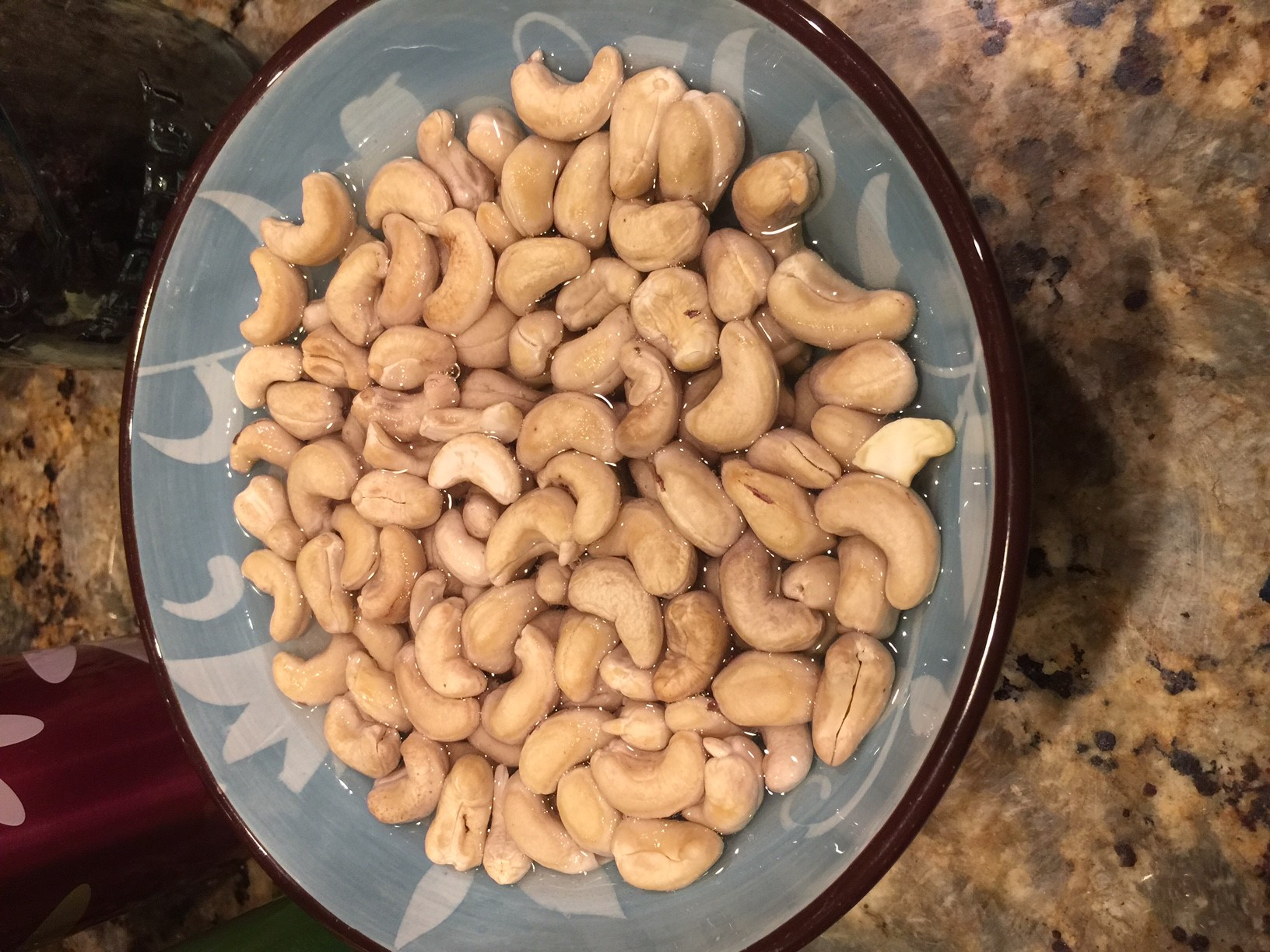 Soaking cashews before making fruit and nut bars (cashews, figs, dried cherries without sulfites, and dates).