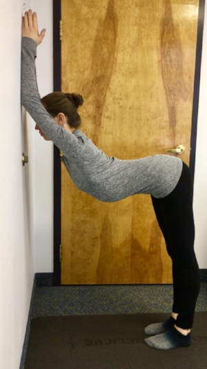 press elbows and forearms into the wall and walk feet back until they're under hips. Start with elbows shoulder height and work your way up until you feel a stretch along the sides and under the armpits. Reach back through the tailbone and breathe deeply. Hold for 8-10 breaths.