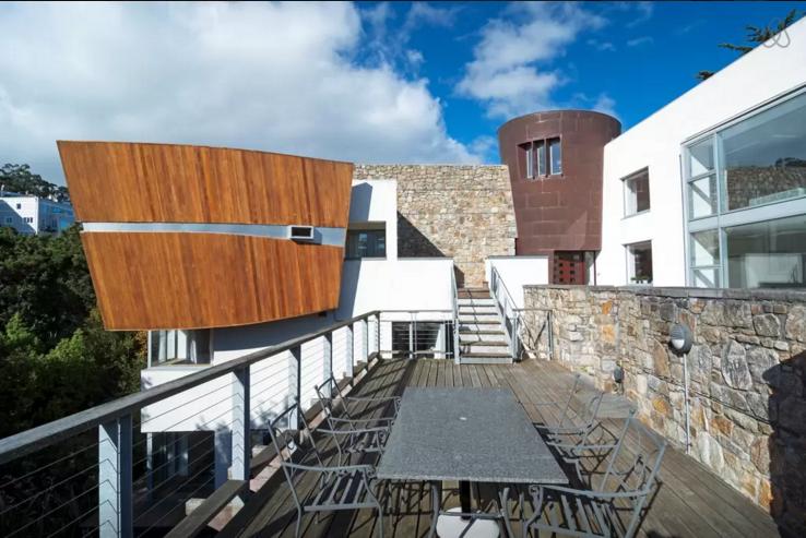 Impressive exterior with large raised balcony