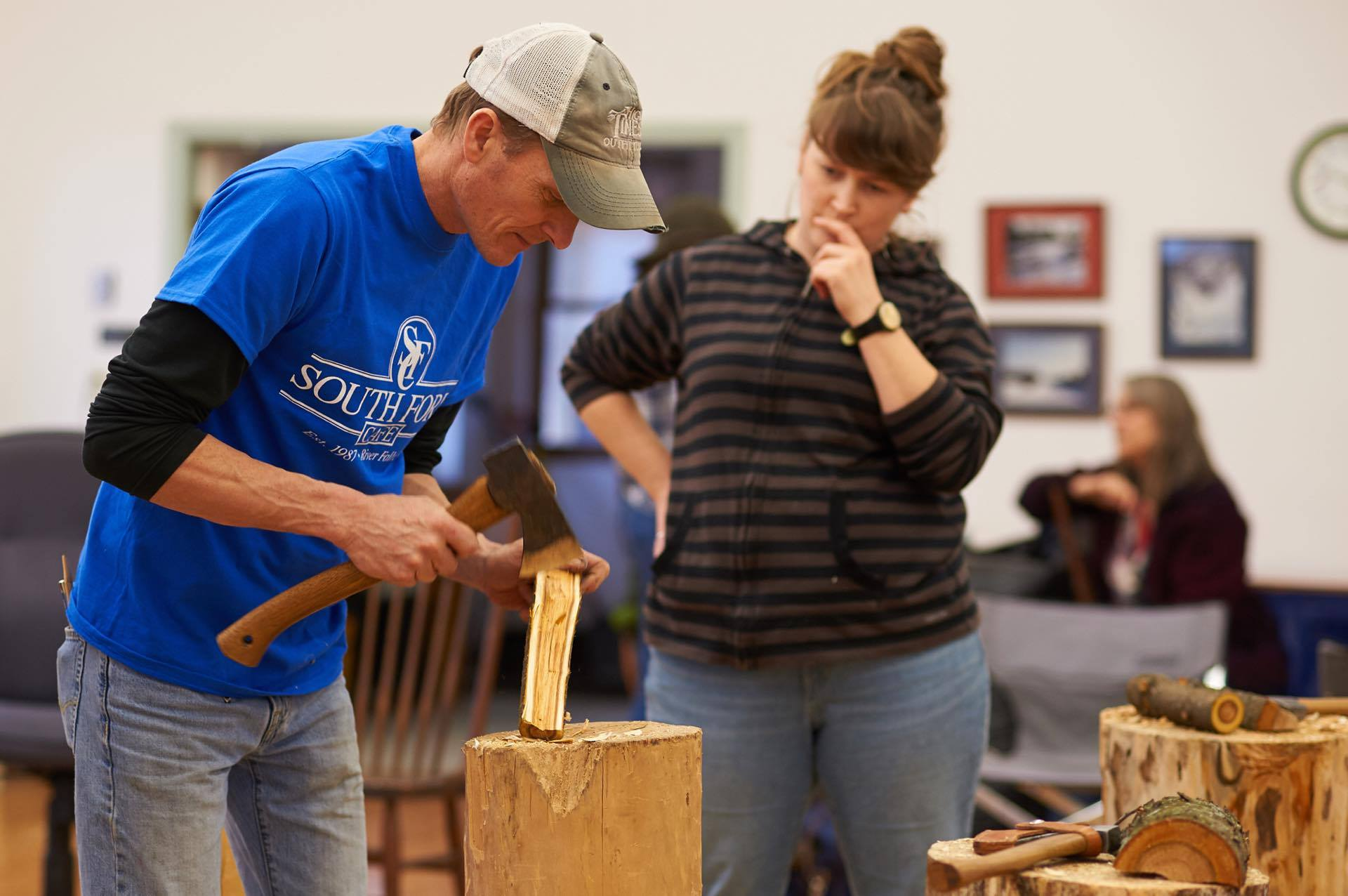 Yuri Moldenhauer showing  Greta Jaeger  some carving techniques.  Photo credit: Derek Brabender