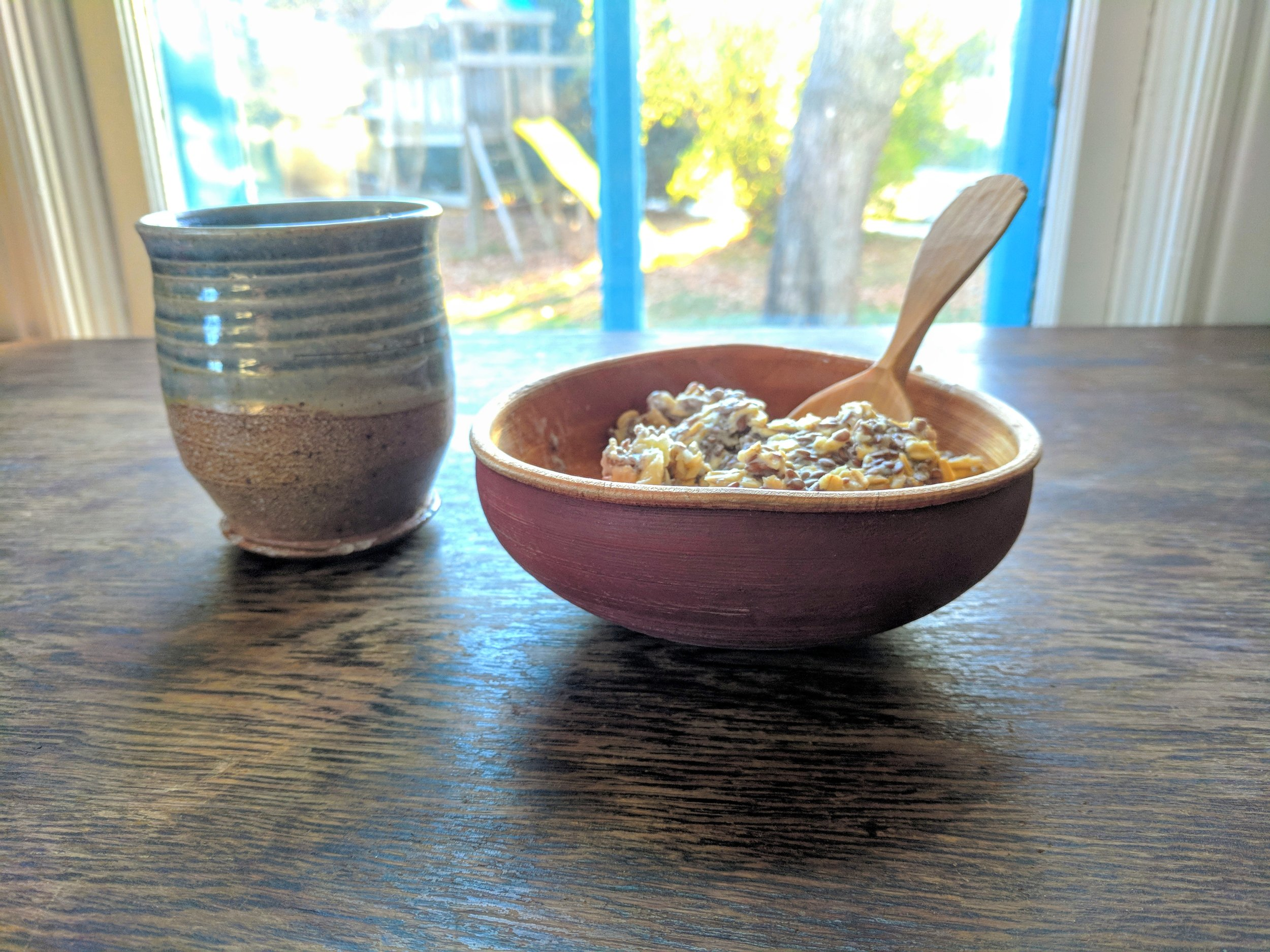 wooden bowl wooden spoon and ceramic mug