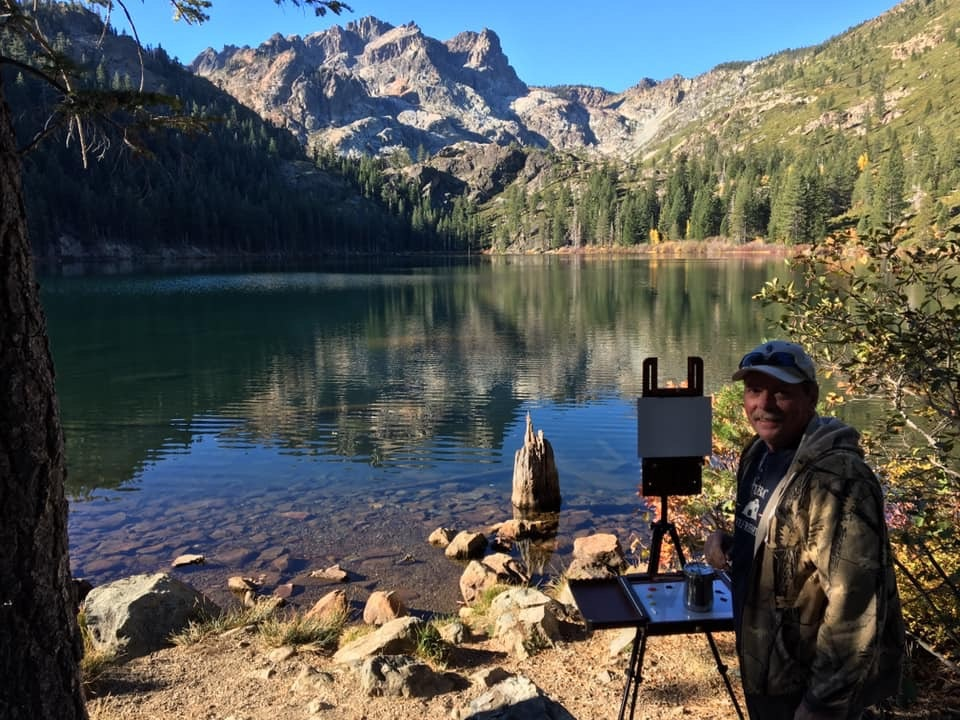"John Nichols painting ""en plein air"" at Sardine Lake, Sierra Buttes ."