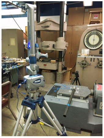 Ae105 students testing boom accuracy with a FARO arm after vibration testing.