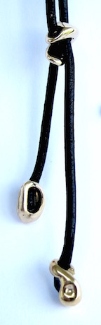 "All puppies come with a 26"" black leather leash and Stevenson's signature sliding clasp in matching metal"